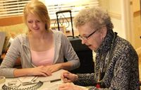 Maddie working with a resident of a local senior center