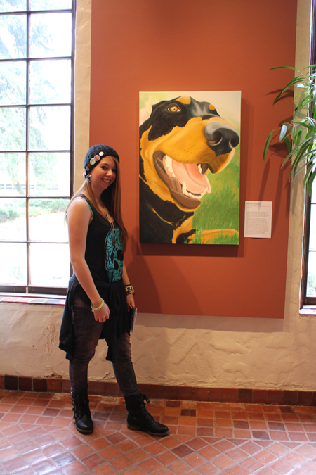 My student next to her own painting in the All State High School Show